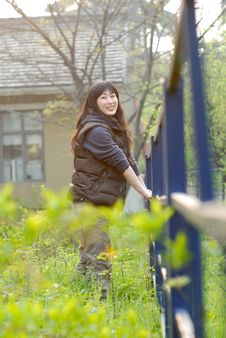 Free Chinese Young Lady Standing In The Backyard Royalty Free Stock Photography - 8905897