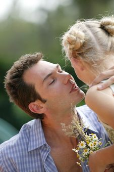 Free Young Man Kissing Little Girl Royalty Free Stock Photography - 8906757