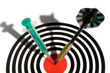 Syringe In A Dartboard Royalty Free Stock Photography