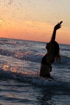 Woman Splashing By Sunset Stock Images
