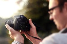 Free Person Holding Camera During Day Time Royalty Free Stock Image - 89060936