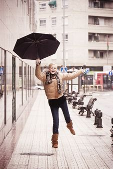 Happy Blonde Under Rain Stock Photo