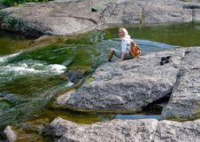 Free A Happy Woman On Big Stone Beside Rapid Stream. Stock Photo - 8912300