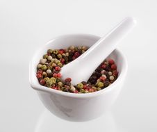 Peppercorns In A Porcelain Mortar Royalty Free Stock Image