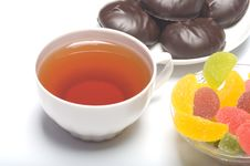 Free Cup With Tea, A Zephyr And Fruit Candy. Royalty Free Stock Images - 8913829