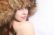 Portrait Of The Girl In A Fur Cap. Royalty Free Stock Photo