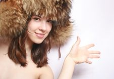 Portrait Of The Girl In A Fur Cap. Stock Images