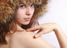 Portrait Of The Girl In A Fur Cap. Stock Image
