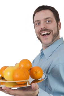 Free Young Man Serving Fruit With Big Smile Stock Photos - 8925073