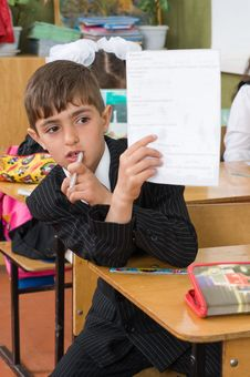 The First-grader Holds A Sheet Of Paper. Stock Images