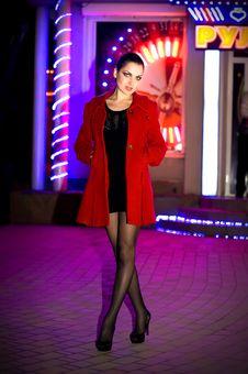 Brunette Walks On A Night City Stock Photo