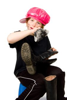 Free Little Bootblack Girl Is Shining Up The Shoes Royalty Free Stock Photo - 8931895