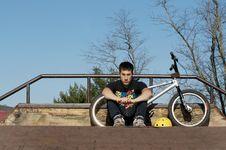 Bmx Rider Sitting At Skate Park Royalty Free Stock Photos