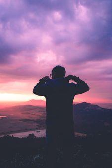 Free Man On Hillside At Sunset  Stock Photography - 89306052