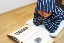 Free Boy Is Reading An Old Book Stock Photography - 8941952