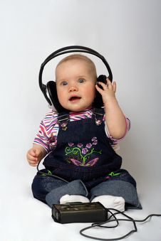 Free Little Girl Listen Music Stock Photos - 8947573