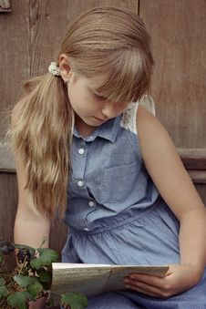 Free Portrait Of Young Girl Reading Outdoors Royalty Free Stock Images - 89441699