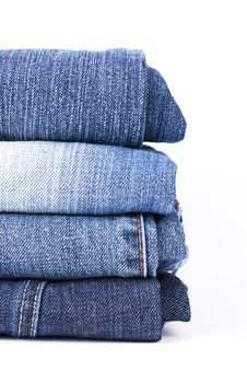 Free Stack Of Blue Jeans Royalty Free Stock Images - 8950229