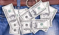 Free Many Hundred Dollar Bills Lying On Blue Jeans Royalty Free Stock Photography - 8950237