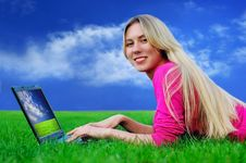 Free Beautiful Girl With Laptop On The Green Grass Stock Photography - 8951802