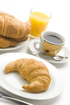 Free Continental Breakfast Of Coffee And Croissants Stock Photo - 8952870