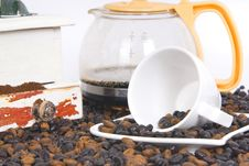 Cup Of Coffee Over Coffee Grain With Coffee Pot Stock Photo