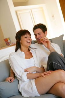 Free Young Couple Sitting On Sofa Royalty Free Stock Image - 8956926
