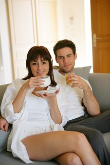 Young Couple Sitting On Sofa Royalty Free Stock Photography