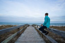 Free Person Sitting On A Wooden Walkway Royalty Free Stock Photo - 89505685