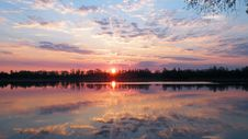 Free Sun Set Reflecting In Calm Lake Royalty Free Stock Image - 89506776
