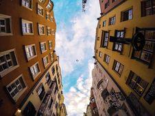 Free Airplane In Sky Between Buildings Stock Photos - 89507783