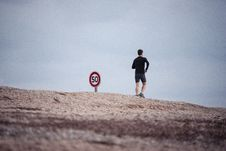Free Man Jogging Next To Road Sign Stock Photos - 89508163