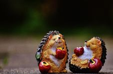 Free Hedgehogs With Apples Figurines Royalty Free Stock Image - 89570796