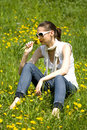 Free Young Woman In Nature Smelling A Flower Royalty Free Stock Images - 8964399