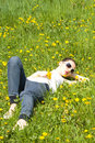Free Young Woman Relaxing In Nature Holding Flowers Stock Photography - 8965372