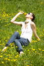 Free Young Woman In Nature Smelling Flowers Royalty Free Stock Photo - 8966725