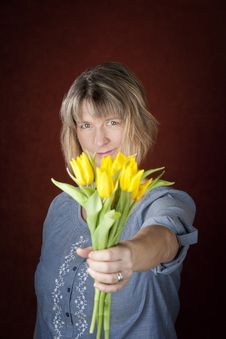 Free Woman With Yellow Tulips Stock Image - 8962931