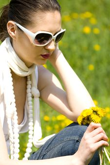 Free Young Woman In Nature Holding Flowers Royalty Free Stock Image - 8964816