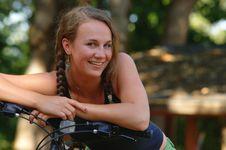 Free Teenage Girl Resting On Handlebars Of Bike Royalty Free Stock Photography - 8965257