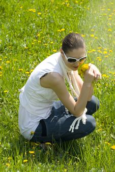 Free Young Woman Relaxing In Nature Holding Flowers Royalty Free Stock Photos - 8965458