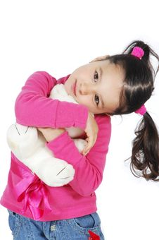 Free Little Girl Hugging A Teddy Bear Royalty Free Stock Photo - 8965515