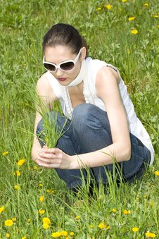 Free Young Woman In Nature Holding Grass Stock Images - 8965744