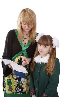Free Mother Is Looking At School Record Book. Stock Photography - 8965942