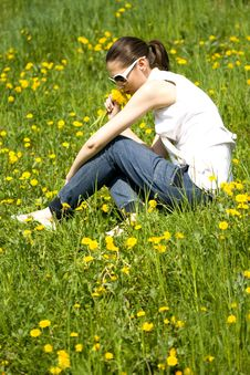 Free Young Woman In Nature Smelling Flowers Royalty Free Stock Image - 8966786