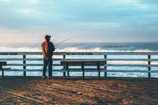 Free Man Fishing At Beach Against Sky Royalty Free Stock Photo - 89636335