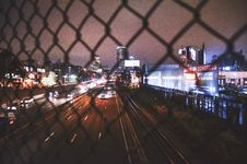 Free Car On Road Near City Buildingsblack Chain Link Fence Look At City Skyline At Nigh T Royalty Free Stock Photography - 89637377
