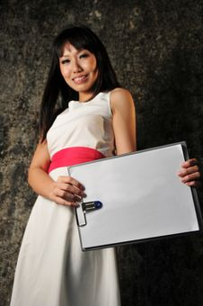 Free Beautiful Asian Woman With Clipboard Stock Photo - 8973070