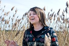 Young Girl Laughing In Field Royalty Free Stock Photo