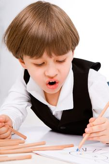 Adorable Little Boy With Pencil Stock Images