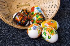 Easter Painting Eggs And Small Basket Stock Photos